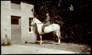 Photograph of a young man on a horse