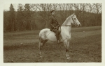 Photograph of a young man on horseback