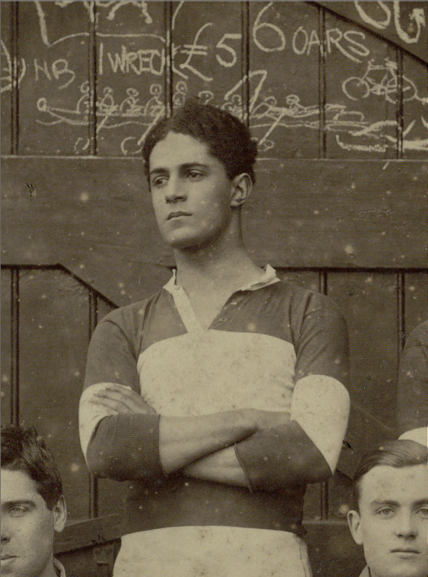Photograph of a young man with arms folded
