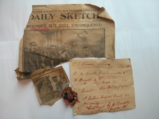 News clippings, note and rosette