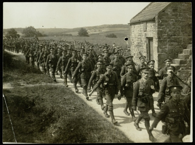Line of soldiers marching on a country lane, 1915