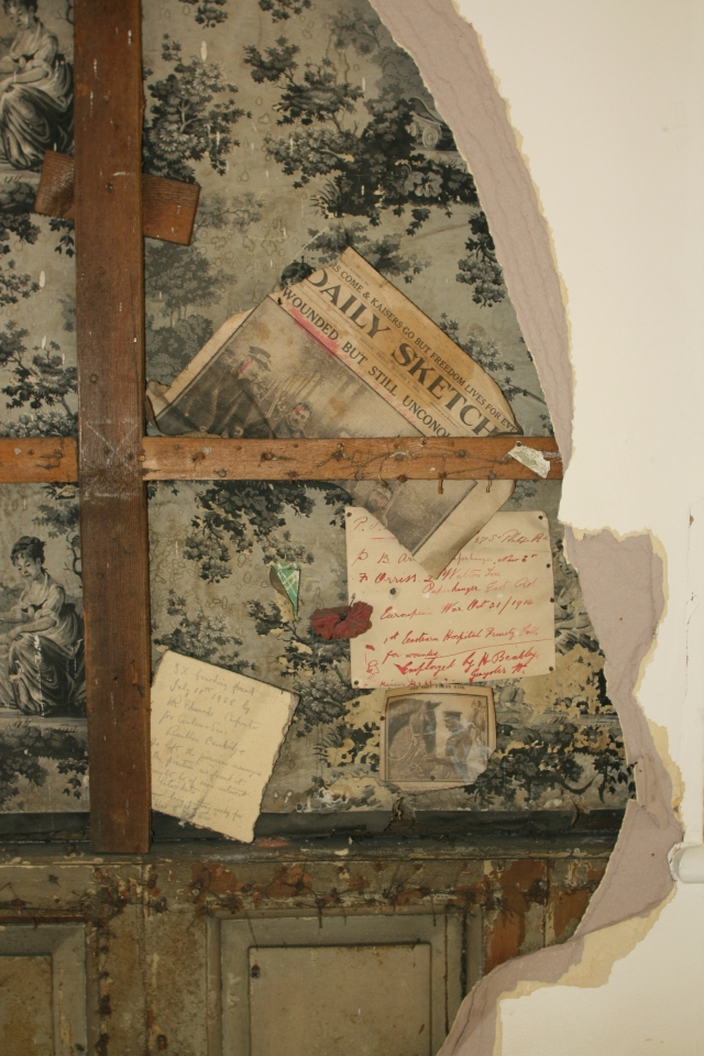 Newspaper clippings etc. affixed behind a wall