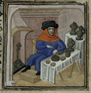 Image of a man feasting before a fire from Trin MS B.11.31, f.1r