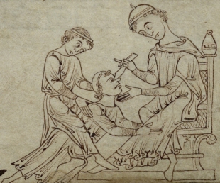 An assistant holds the patient while the doctor removes a facial tumor. f. 260r.