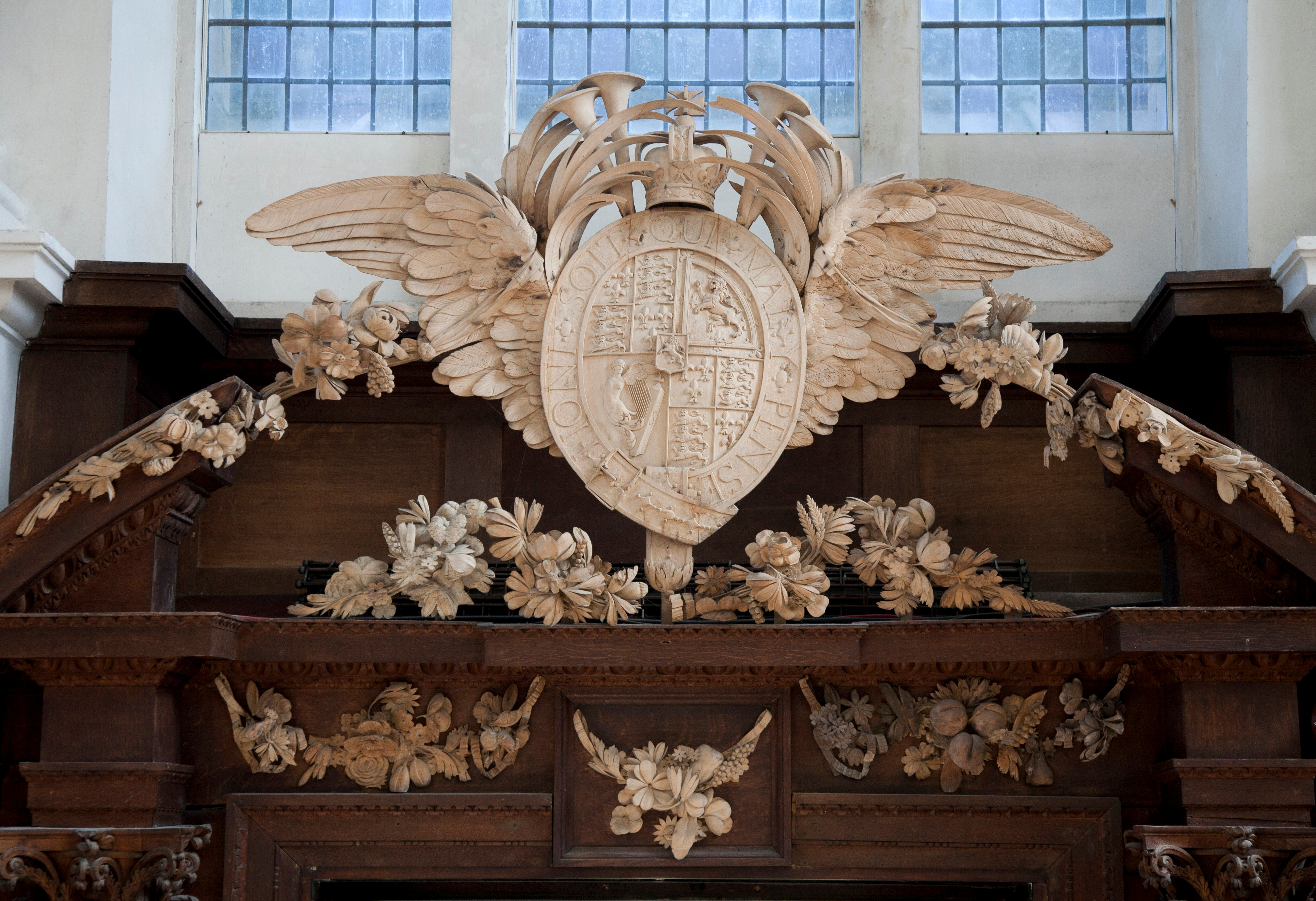 Pediment, north door, Wren Library (arms of William III and other decorative elements)